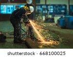 worker using electric wheel... | Shutterstock . vector #668100025