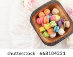 colorful macaroons in a wooden... | Shutterstock . vector #668104231