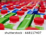 colorful juice cartons with red ... | Shutterstock . vector #668117407