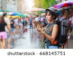 young asian woman traveler with ... | Shutterstock . vector #668145751