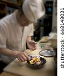 japanese chef is using knife to ... | Shutterstock . vector #668148031