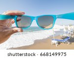 travel concept with a hand... | Shutterstock . vector #668149975
