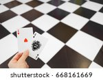 hand holding ace cards  red... | Shutterstock . vector #668161669