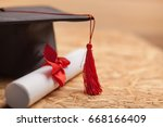 graduation cap and diploma. | Shutterstock . vector #668166409