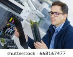 young engineer in the lab... | Shutterstock . vector #668167477