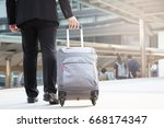 businessmen drag luggage to... | Shutterstock . vector #668174347