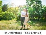 couple is hugging  green...   Shutterstock . vector #668178415
