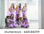 Stock photo cheerful women team veterinary holding her pets veterinary concept 668186059
