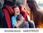 mid shot of joyful mother... | Shutterstock . vector #668199025