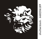 relief of lion's head  growling ... | Shutterstock .eps vector #668206189