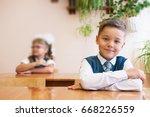 happy schoolboy at school desk. ...   Shutterstock . vector #668226559