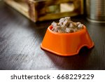 canned pet food in a orange... | Shutterstock . vector #668229229