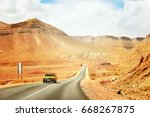 the yellow taxi rides along the ... | Shutterstock . vector #668267875