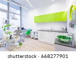 Modern dental room with green and white furniture - stock photo