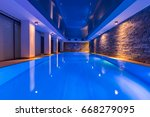 swimming pool with decorative... | Shutterstock . vector #668279095