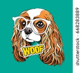 Stock vector portrait of the cavalier king charles spaniel in a glasses and with card woof on a green 668283889