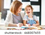 mother and child daughter draws ... | Shutterstock . vector #668307655