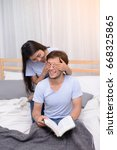 couple play funny while reading ... | Shutterstock . vector #668325865