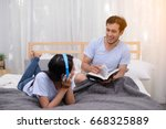 man reading a book while his... | Shutterstock . vector #668325889