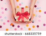 woman hands holding present box ... | Shutterstock . vector #668335759