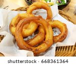 golden crispy onion ring   | Shutterstock . vector #668361364