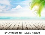 empty wooden table and palm... | Shutterstock . vector #668375005