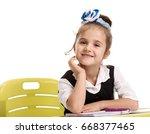 little girl at the desk | Shutterstock . vector #668377465
