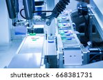 automated picking robotic in... | Shutterstock . vector #668381731