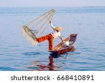 Fisherman On Inle Lake At Dawn