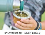 close up pouring hot water into ... | Shutterstock . vector #668418619