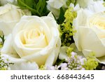 Stock photo bunch of flowers with white roses 668443645