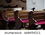 empty wooden benches in old ... | Shutterstock . vector #668454211