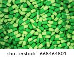 heap of green pill capsules... | Shutterstock . vector #668464801