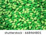 heap of green pill capsules...   Shutterstock . vector #668464801