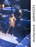 Small photo of USSR, ABKHAZIA, SUKHUMI - CIRCA 1982: Vintage photo of little boy with big toy bear in Sukhumi, Abkhazia, USSR