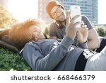 hipster couple relaxing at the... | Shutterstock . vector #668466379