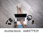 young woman sitting on floor... | Shutterstock . vector #668477929