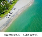 empty sand beach with white... | Shutterstock . vector #668512591