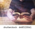 a young man reading holy bible... | Shutterstock . vector #668523061