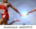 athletes passing relay baton | Shutterstock . vector #668525515