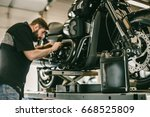 replacing the oil in a...   Shutterstock . vector #668525809