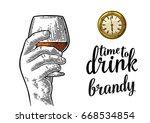 male hand holding glass brandy... | Shutterstock .eps vector #668534854