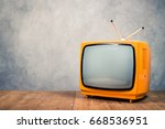 retro old orange tv receiver on ... | Shutterstock . vector #668536951