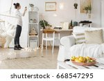 bright and cozy apartment in... | Shutterstock . vector #668547295