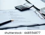 calculations using a calculator | Shutterstock . vector #668556877