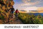 mountain biking women and man... | Shutterstock . vector #668570017