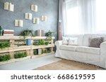 elegant sofa and pallet... | Shutterstock . vector #668619595