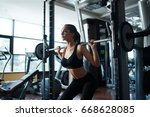 beautiful fit woman exercising... | Shutterstock . vector #668628085