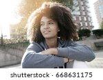 cheerful ethnic girl relaxing...   Shutterstock . vector #668631175