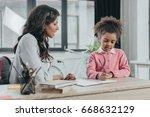 mother helping little daughter... | Shutterstock . vector #668632129